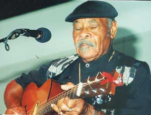 Image of Eddie Cusic playing guitar