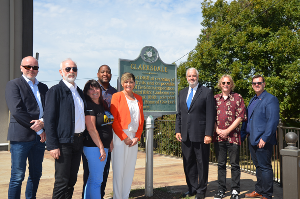 Mayor Bil Luckett and Norwegian delegation outside by historic Clarksdale marker
